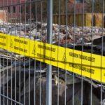 Afzetting hek asbestgevaar